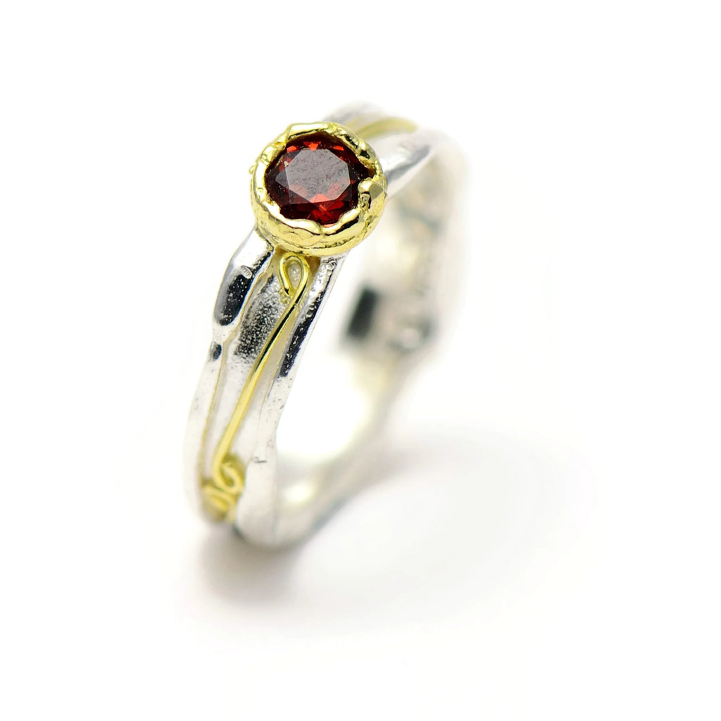 red garnet and gold ring