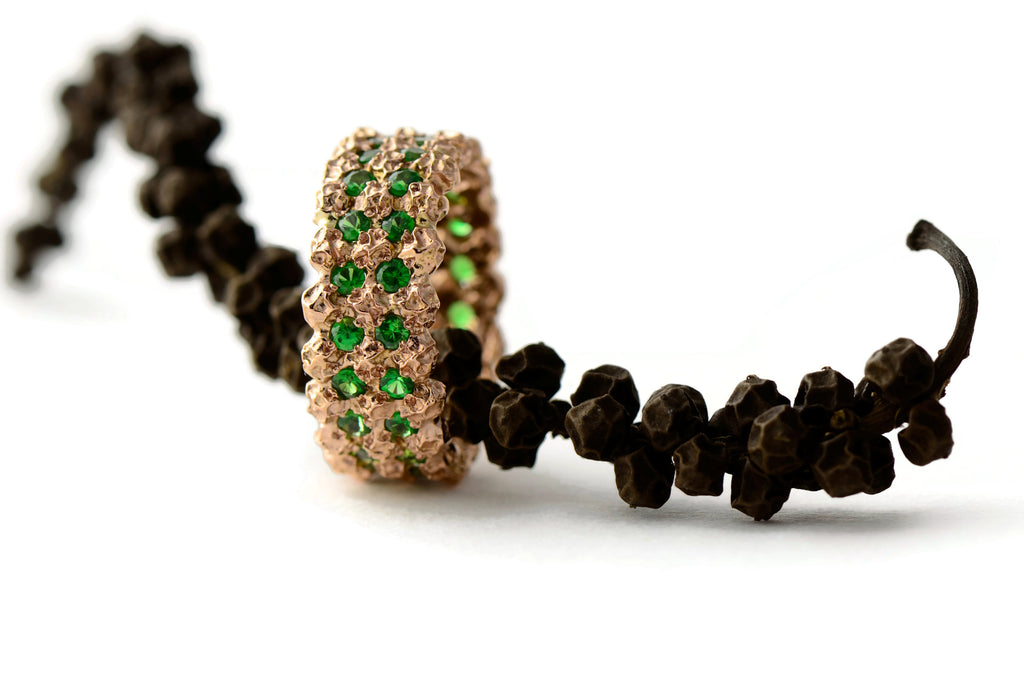 rose gold peppercorn eternity ring with green garnets