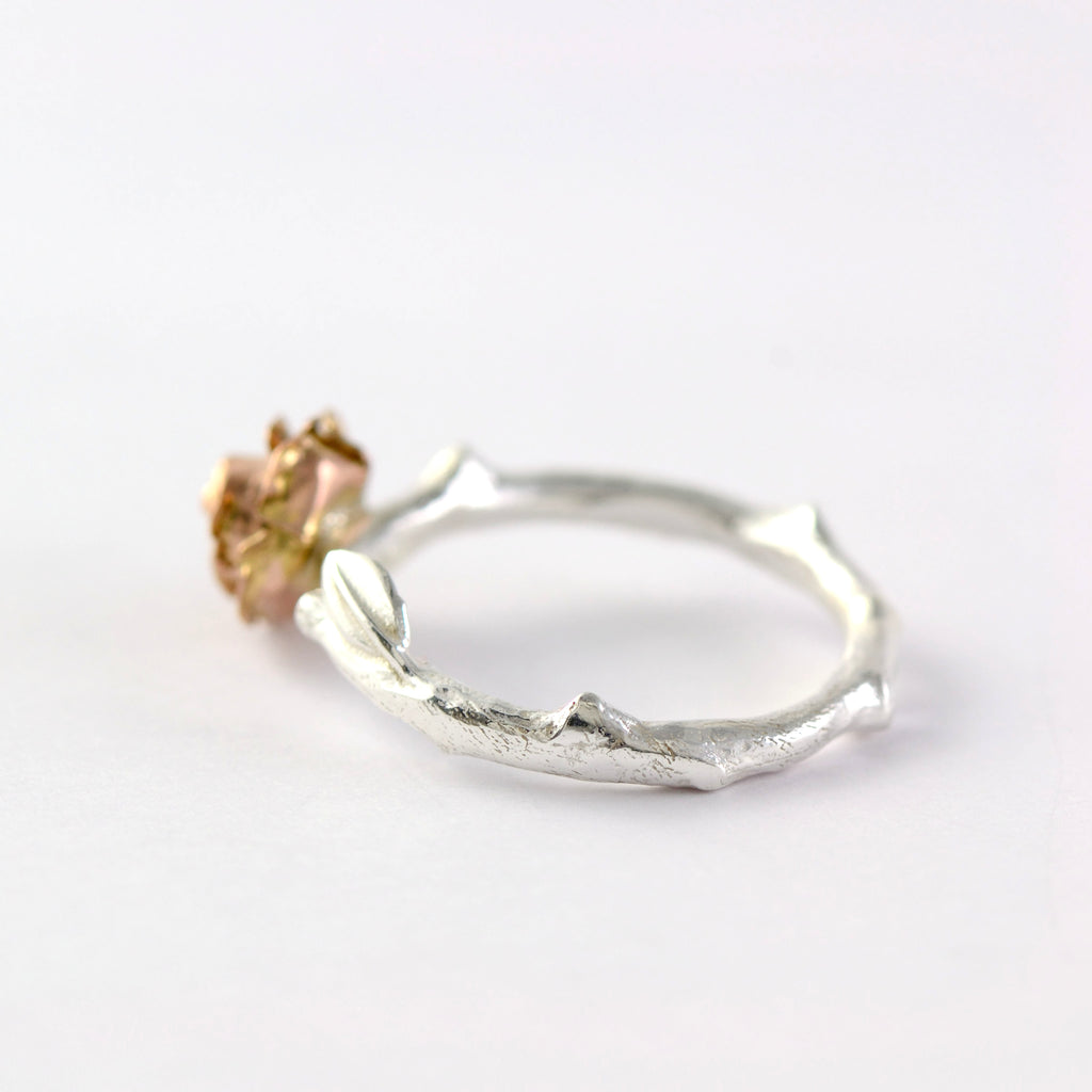 rose stem ring with a 9ct red  gold rose