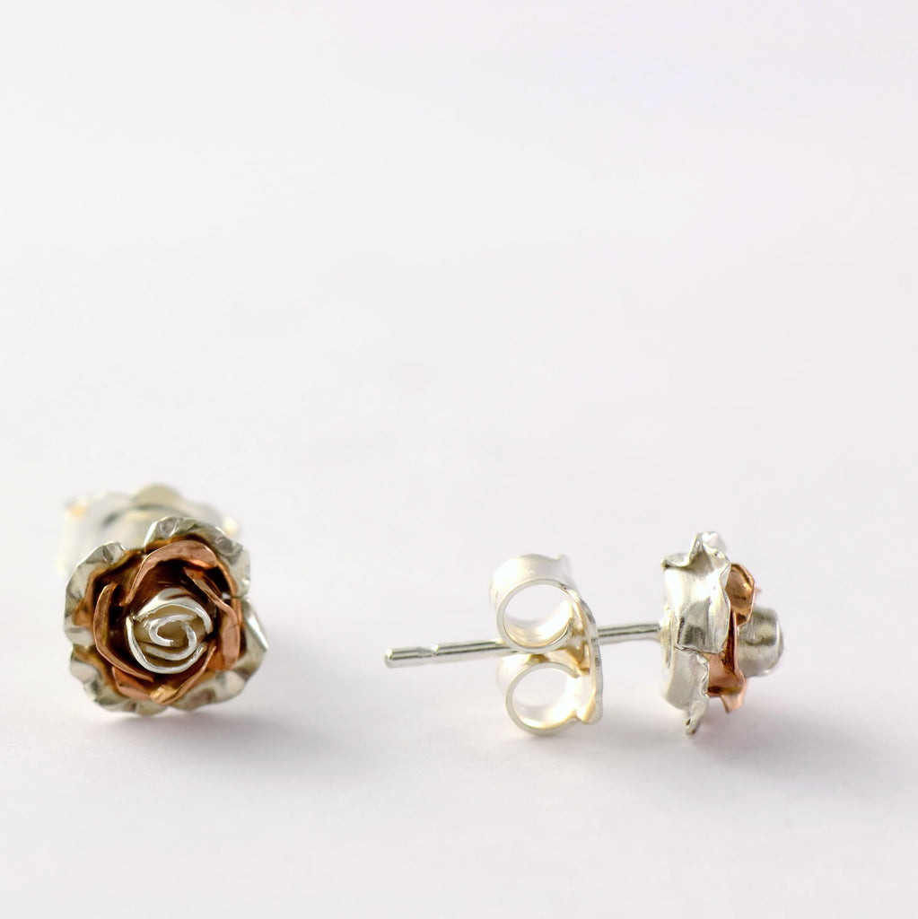 silver and rose gold rose stud earrings