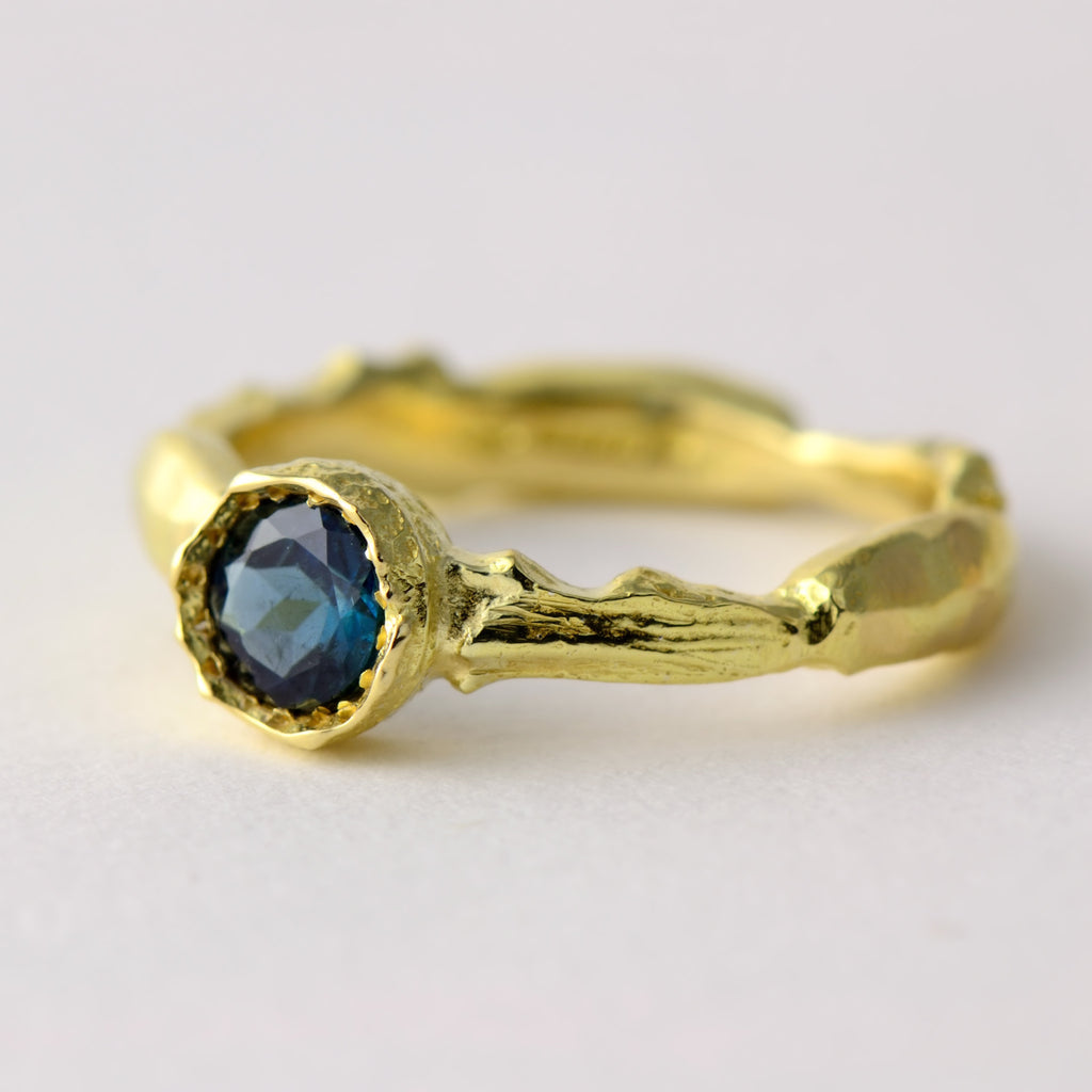 blue gemstone and gold ring