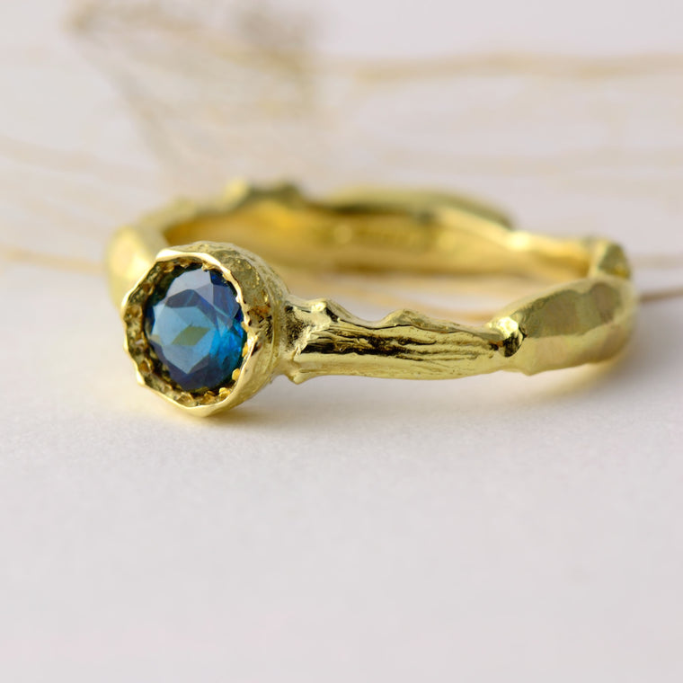 Blue tourmaline and 18 carat gold ring