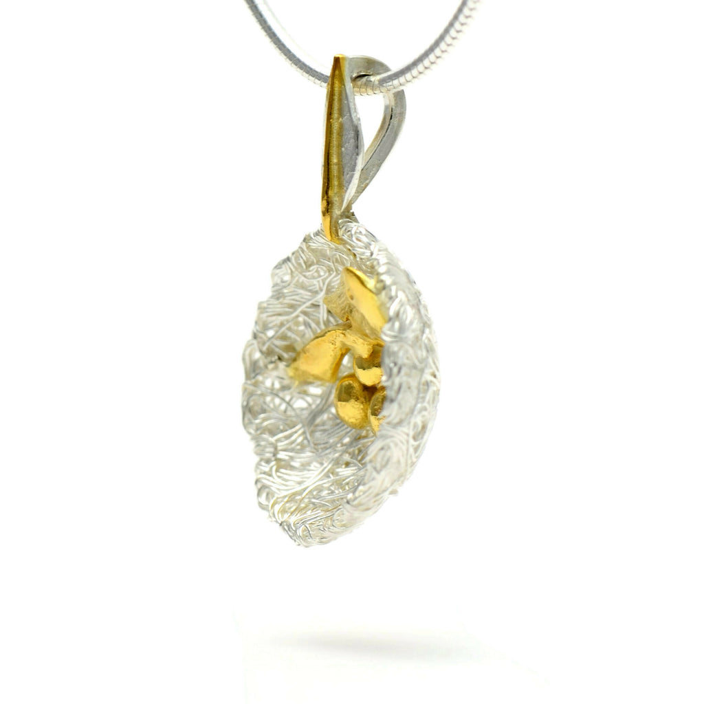 Bird's nest pendant with golden bird and eggs