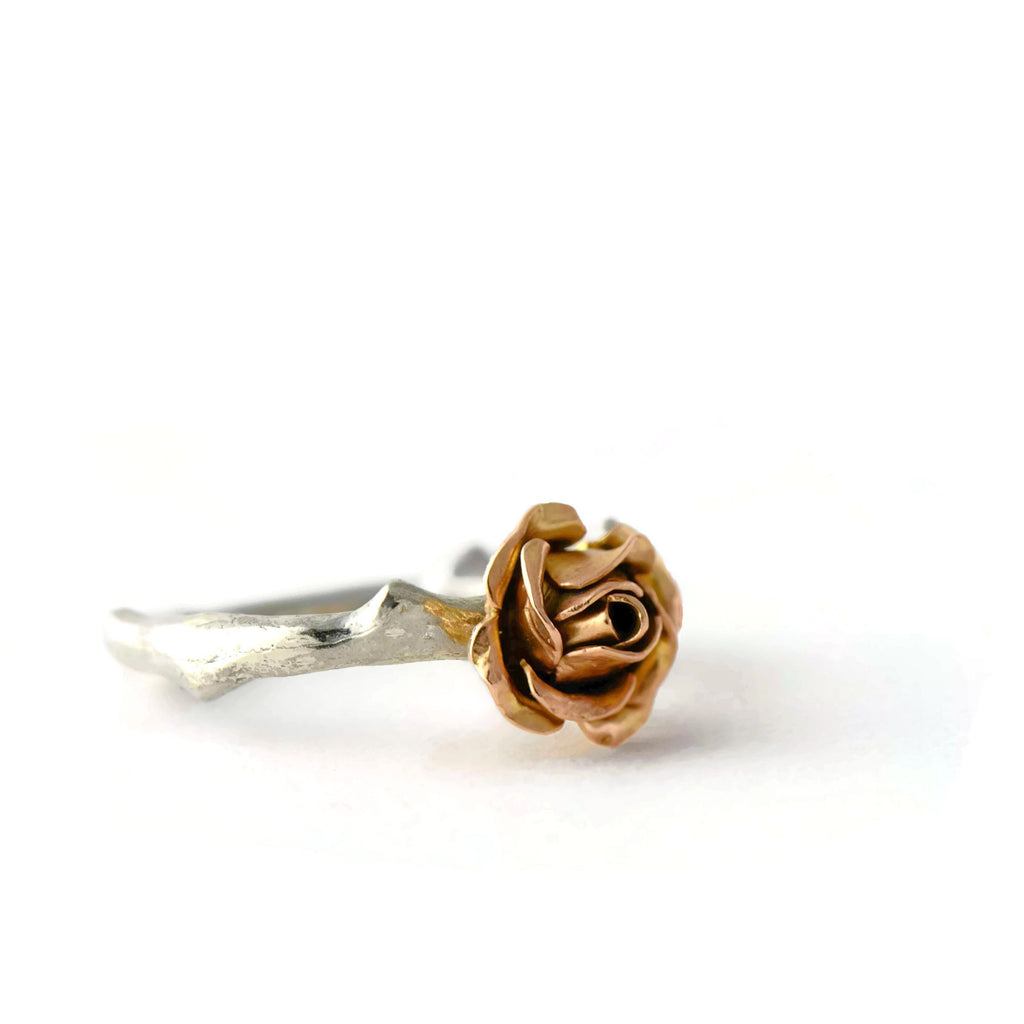 Rose gold rose ring with a silver band