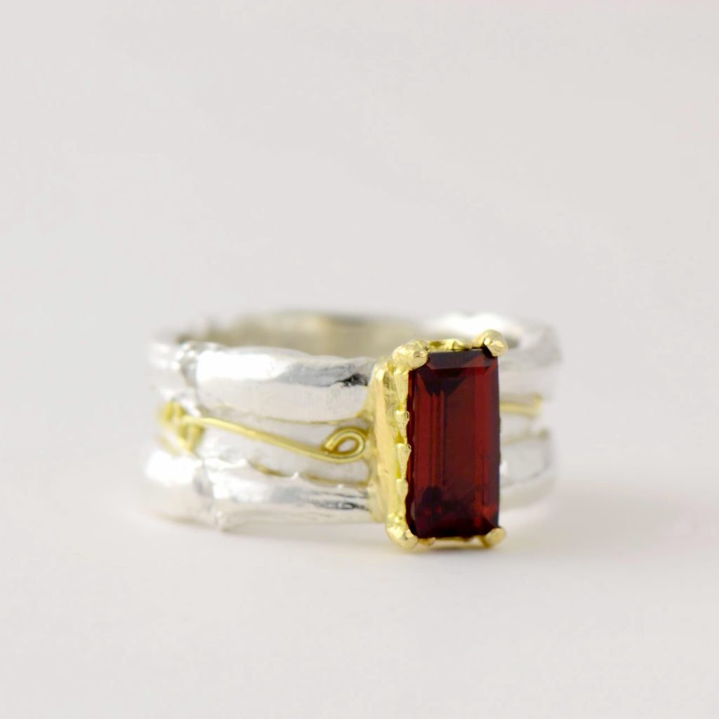 large garnet , gold and silver ring