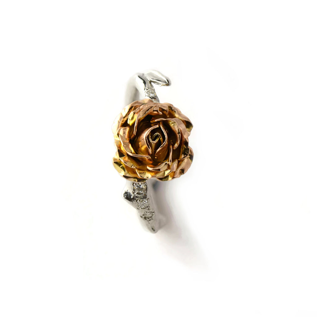 white and rose gold rose ring