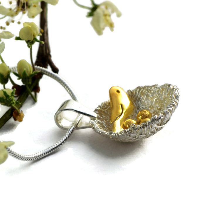 sterling silver nest pendant and gold birds and eggs