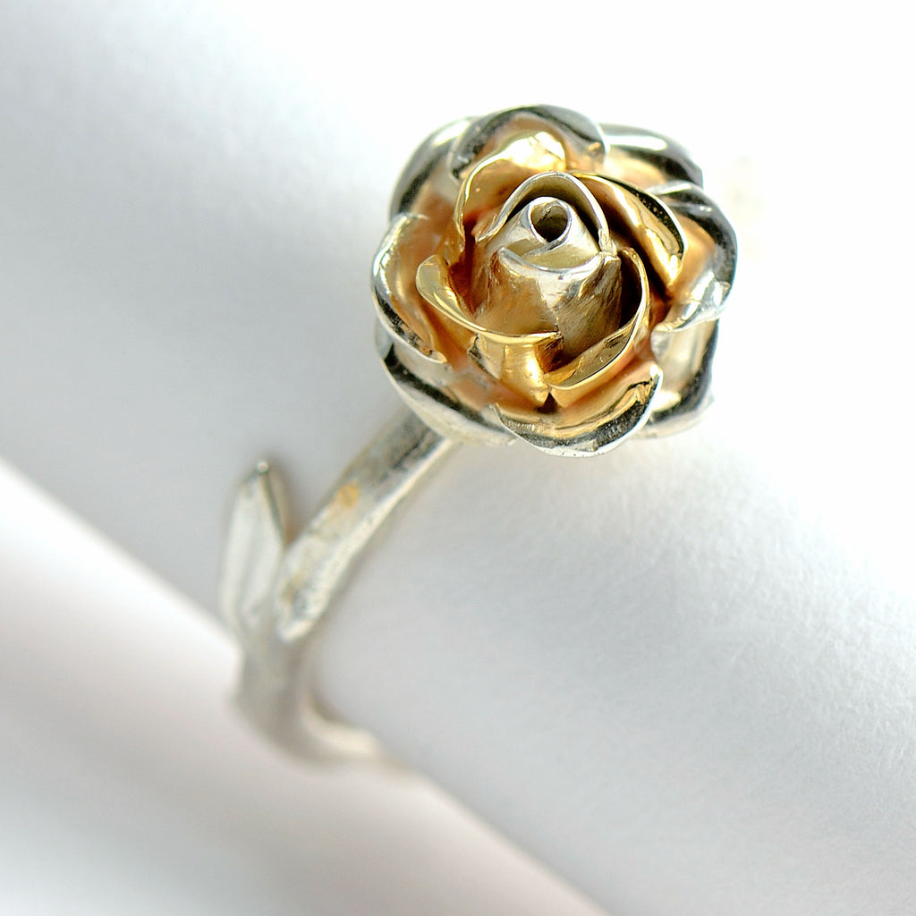 rose gold and silver rose ring