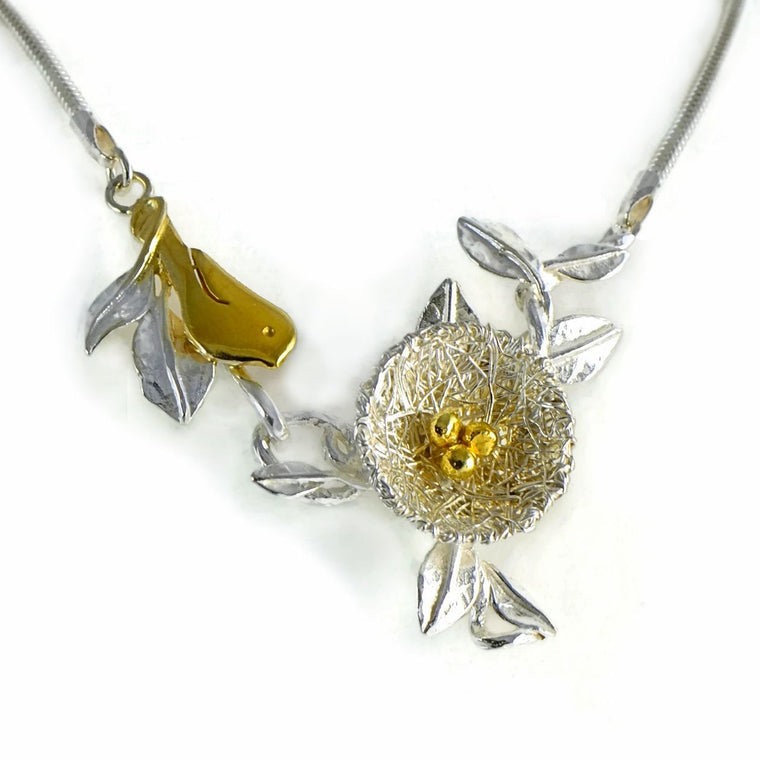 Bird's nest necklace with golden bird and nest eggs