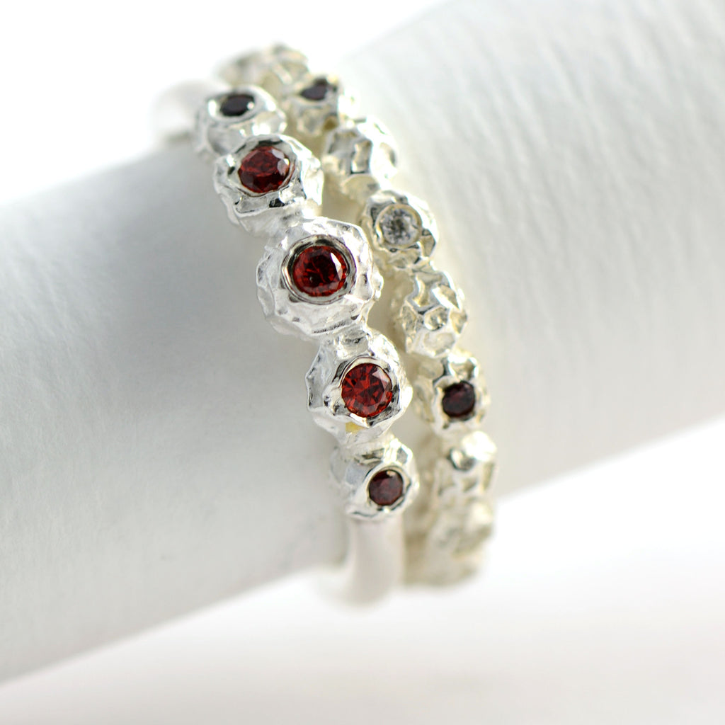 Silver peppercorn eternity rings with garnets and diamonds