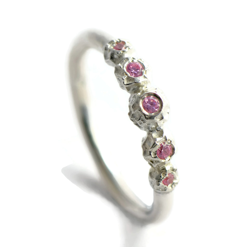 Silver peppercorn eternity ring with 5 pink tourmaline