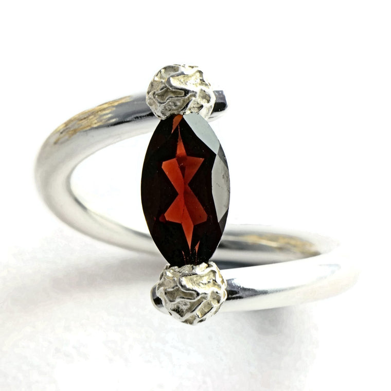 Tension set ring with a marquise garnet