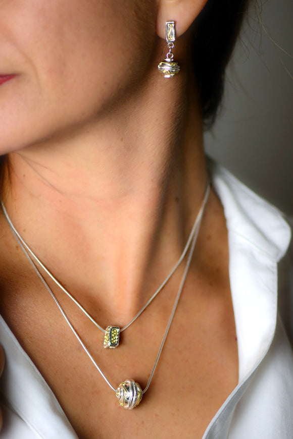 a shere pendant in 18ct gold and silver