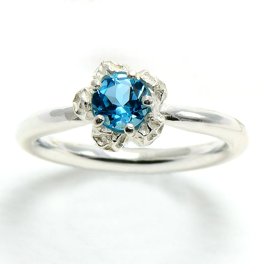 silver solitary blue topaz ring