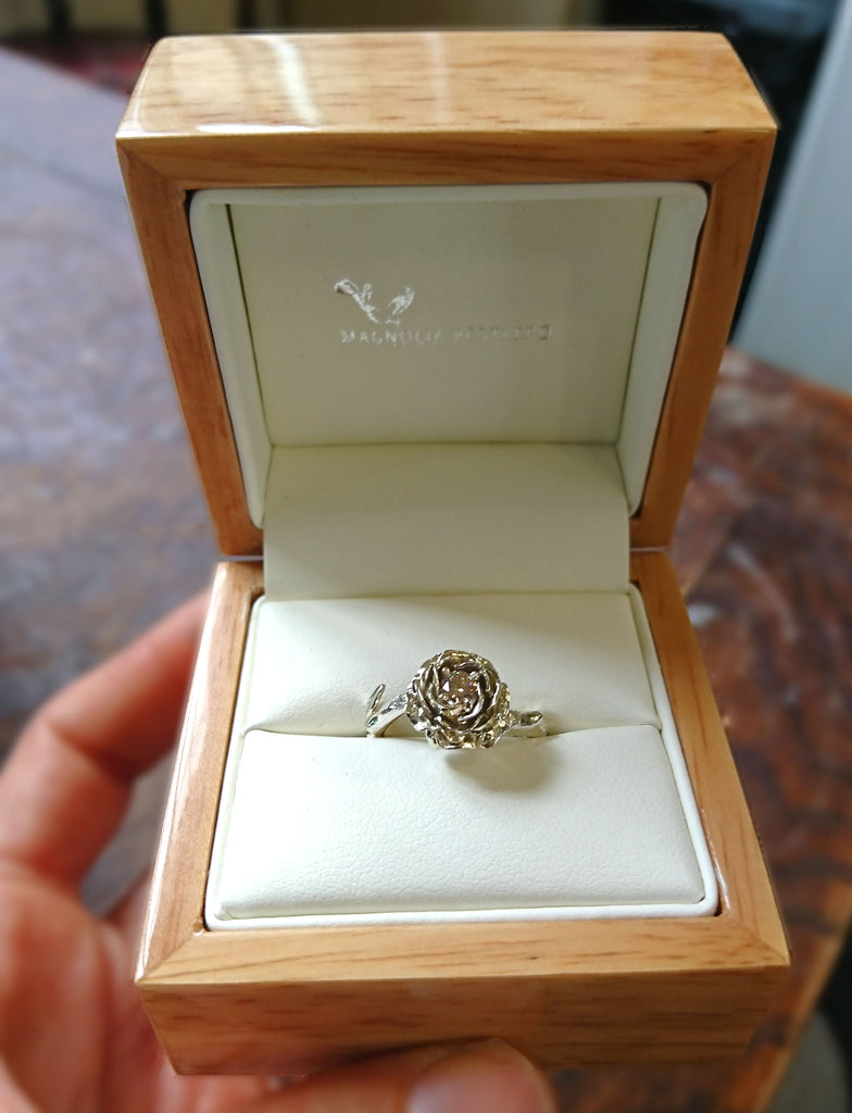 Solitaire rose ring made in 9ct solid rose and white gold, set with 5 tiny diamonds