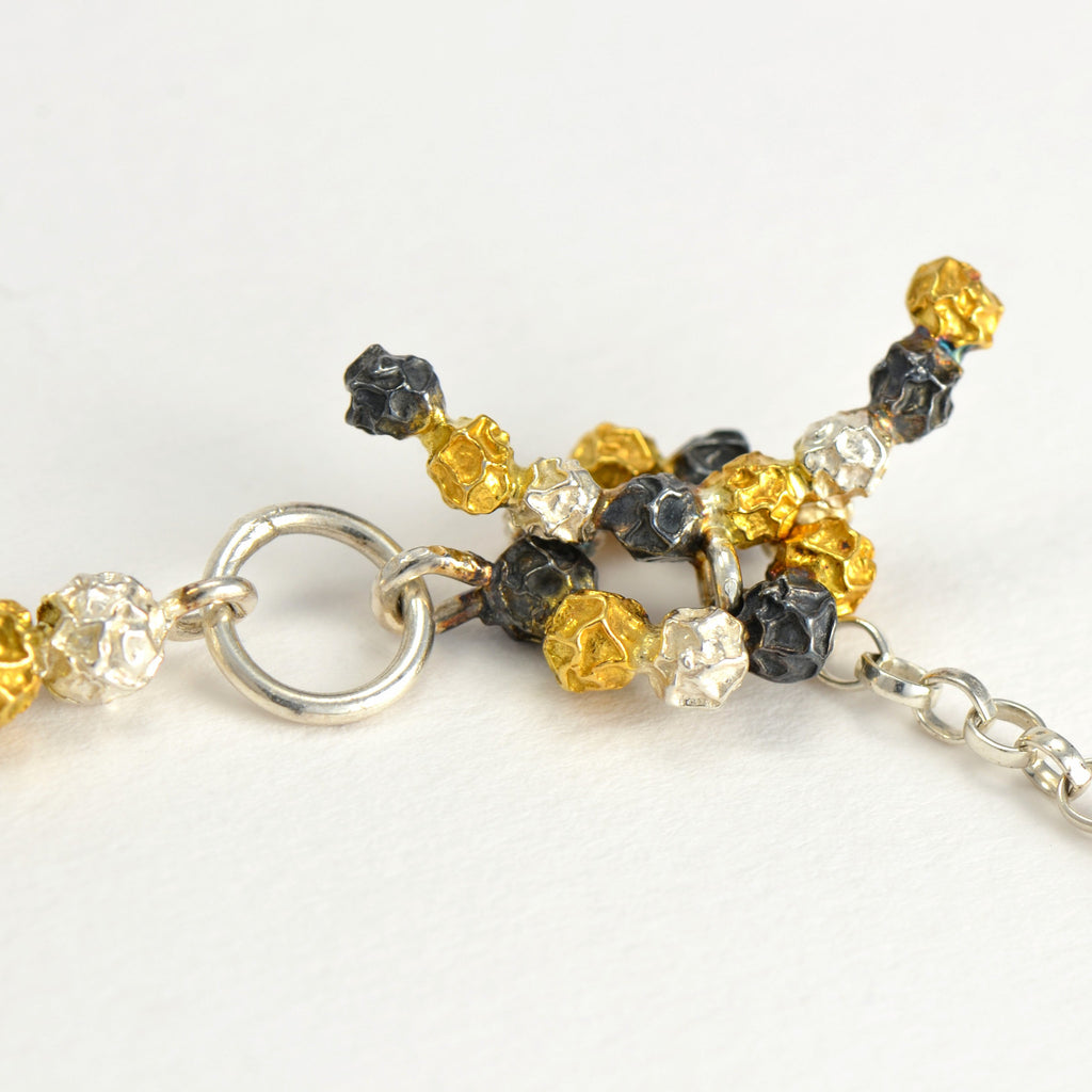 A silver and golden three peppercorn stick bracelet, fruit Bracelet Design