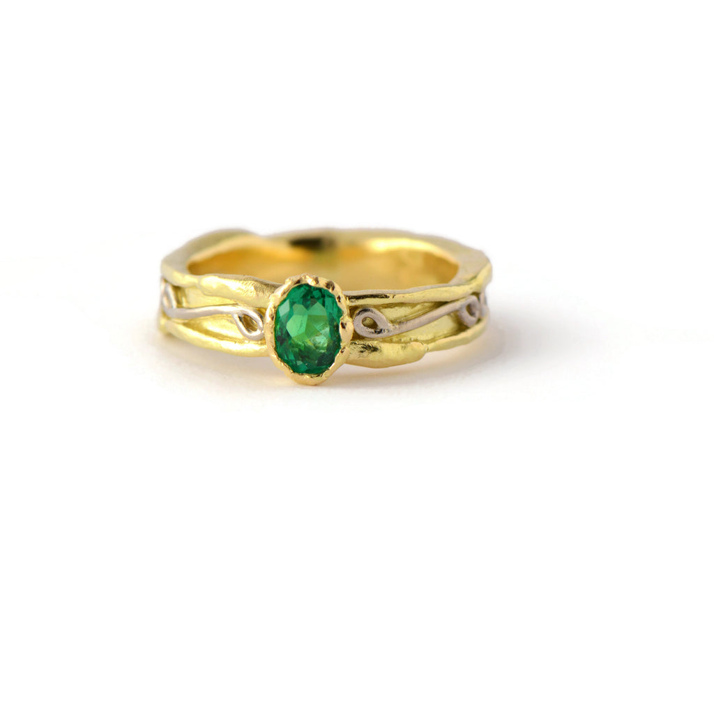unique gold and emerald ring
