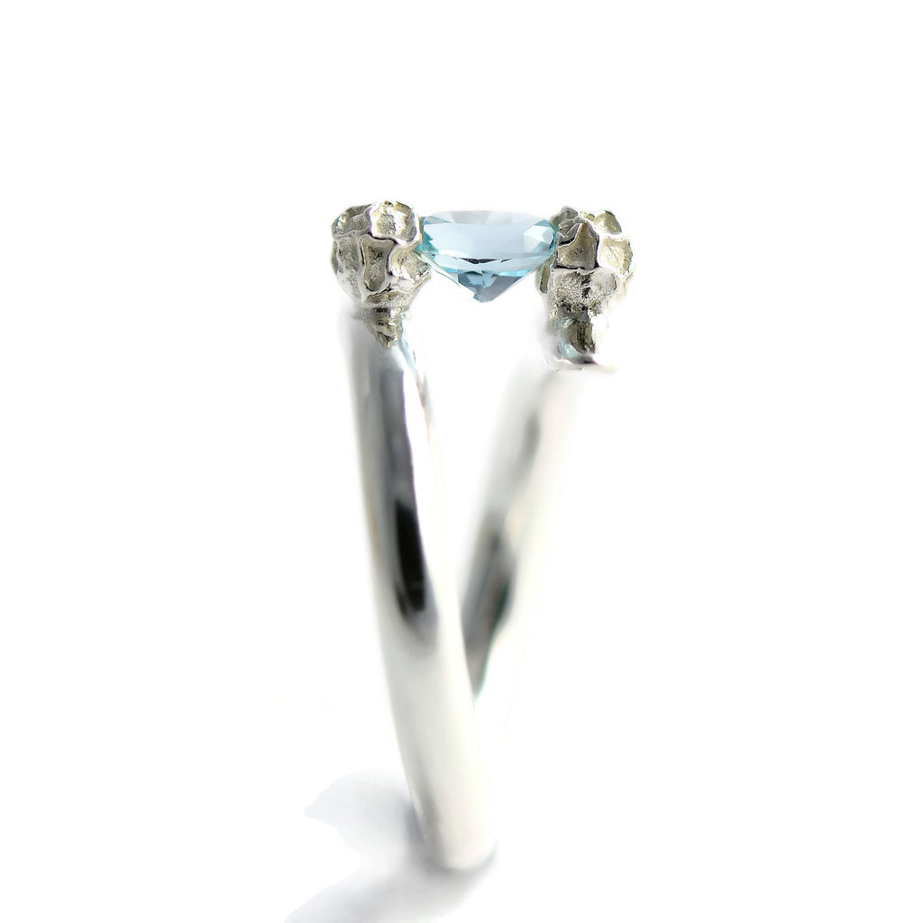 Blue topaz tension set ring, silver peppercorn ring design