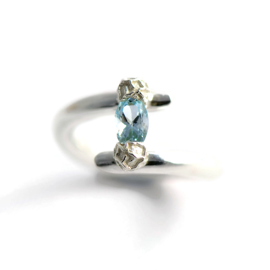 Blue topaz tension set ring, silver peppercorn design