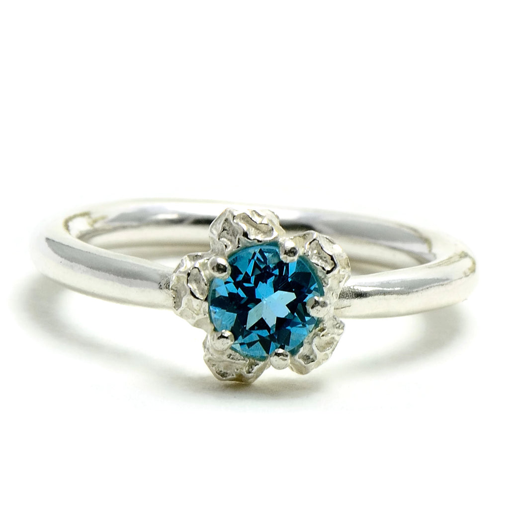 solitary blue topaz ring