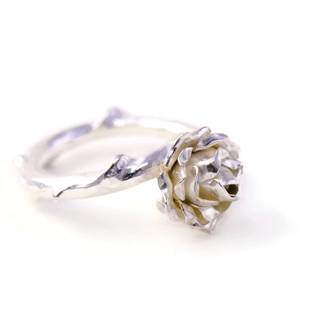 Delicate, small rose ring with a soft rose stem