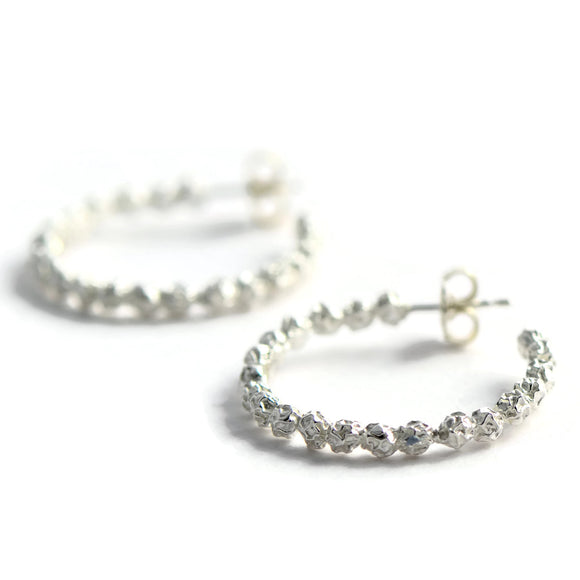 A Large silver peppercorns hoops earrings