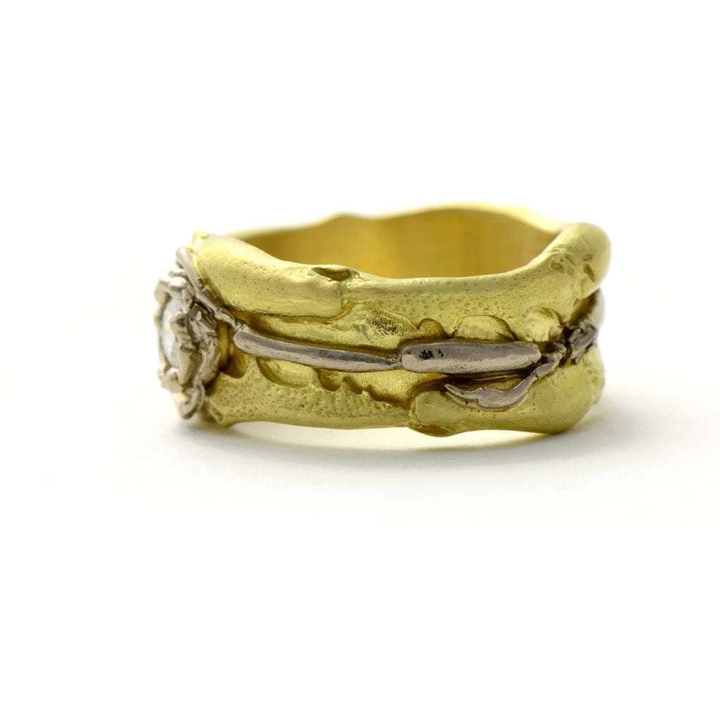 Modern unique gold ring made in 18ct gold and set with a diamond