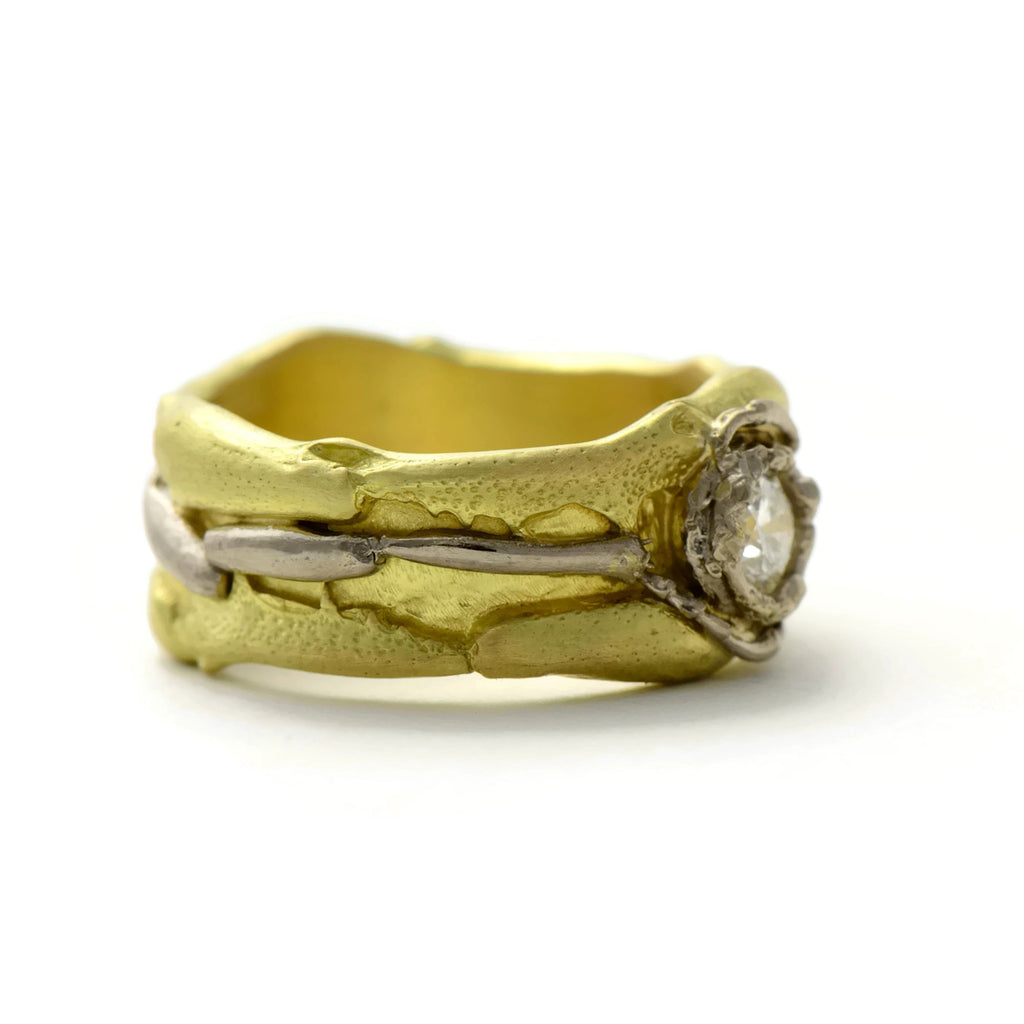 18 carat fairtrade gold ring with a bright diamond and the unique tropical insect texture