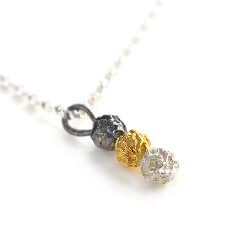 A silver three colours peppercorn stick pendant