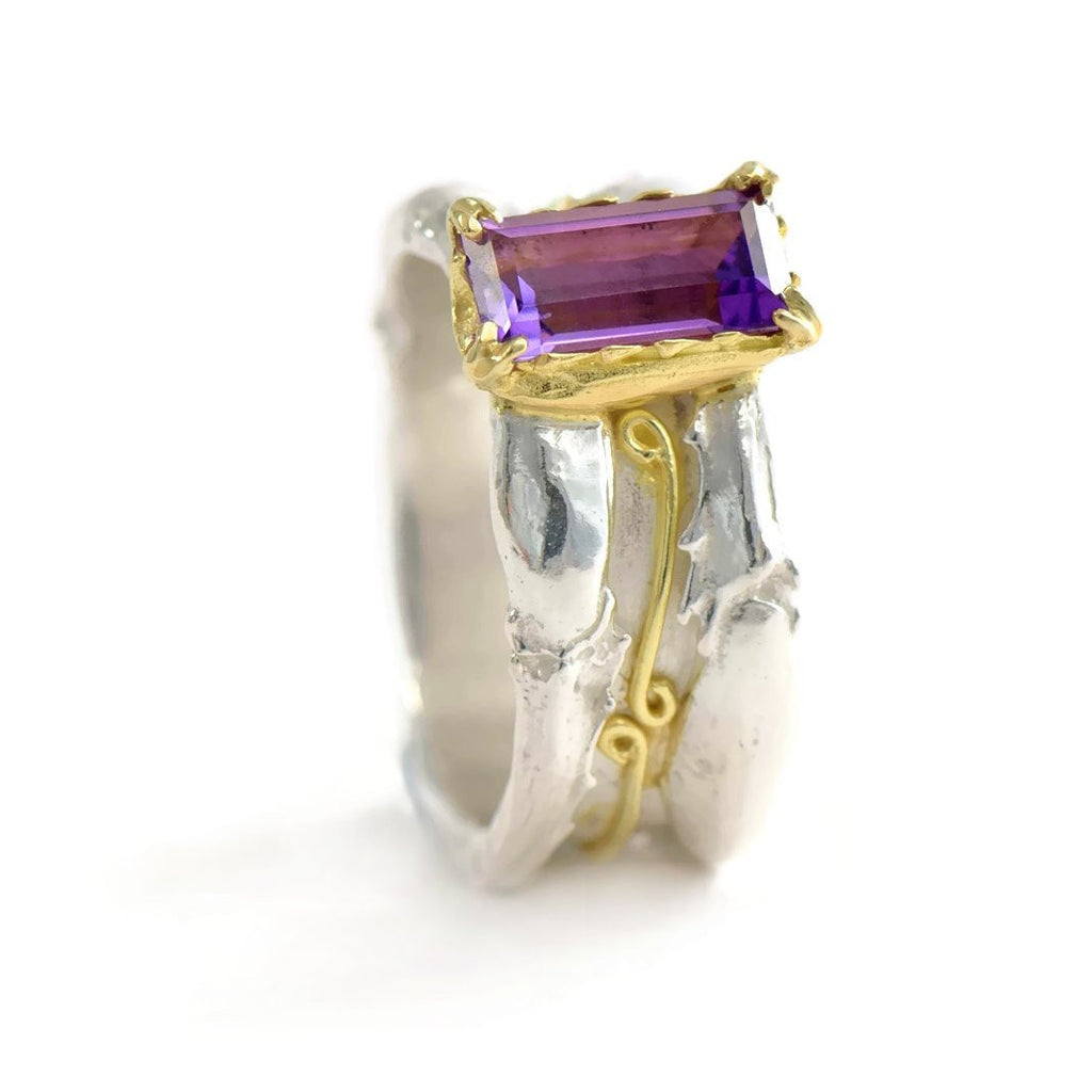 18 ct gold and silver cocktail patterned ring, 10 mm wide with a 10 by 5 mm baguette gemstone