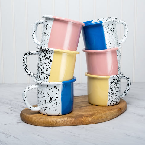 3 color enamel mugs on top of each other in blue pink yellow
