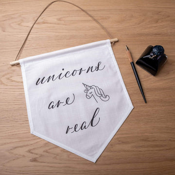 'Unicorns are real' Hand-Calligraphed Linen Banner - Darling Spring