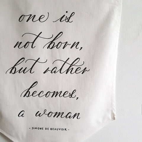 'One is not born, but rather becomes, a woman' Hand-Calligraphed Linen Banner