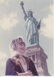 Suhein Beck in 1974 in front of Statue of Liberty wearing her Circassian Ethnic Dress