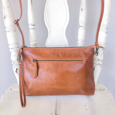 Double zipped leather clutch in vintage tan