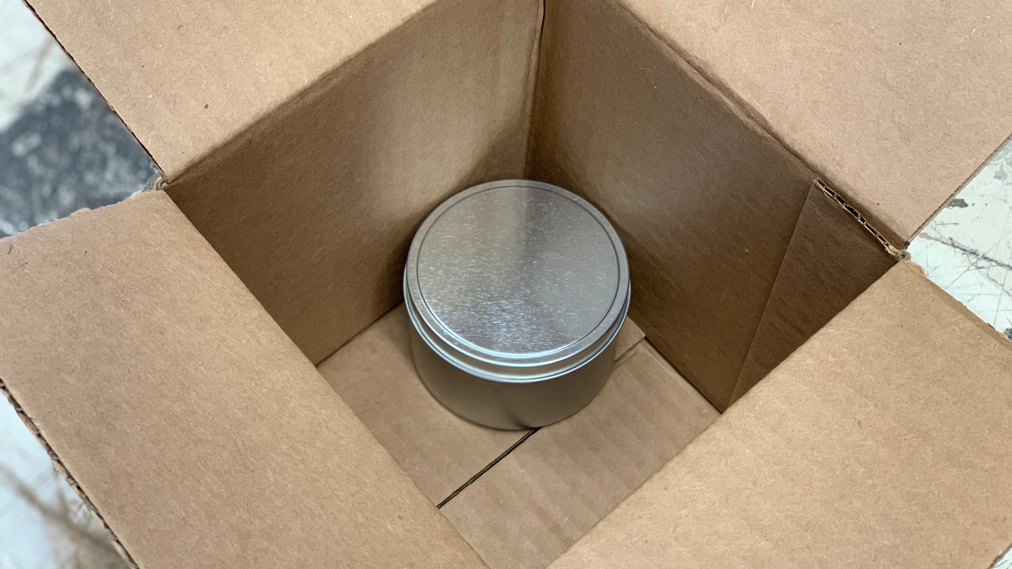 A candle tin a box that's too big