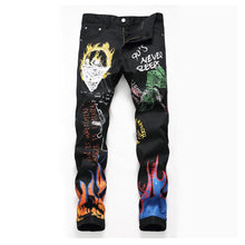 Load image into Gallery viewer, FIRE PRINTED SKINNY JEANS