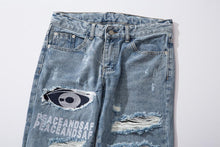 "Load image into Gallery viewer, ""PEACE AND SAFE"" SHREDDED SKINNY JEANS"