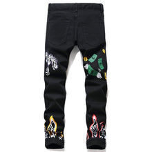 Load image into Gallery viewer, SKULL PRINTED SKINNY JEANS