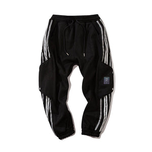 REFLECTIVE STRIPS SUEDE JOGGERS