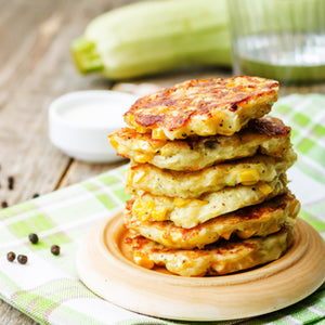 Corn Zucchini Fritters With Avocado Cream
