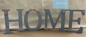 "Wooden ""home"" letters"