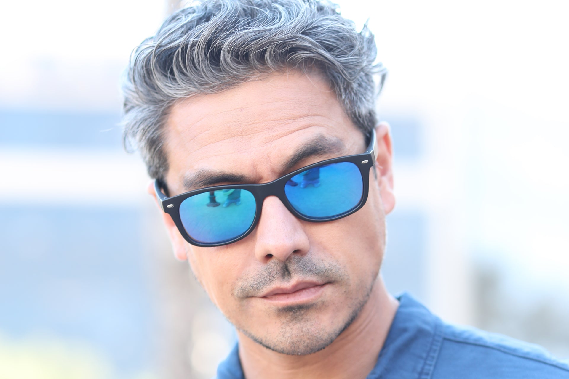 man standing outside wearing a pair of bifocal reading sunglasses