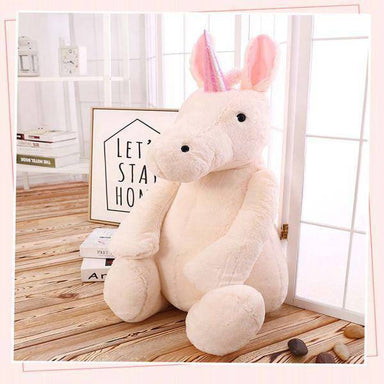 Peluche licorne assise