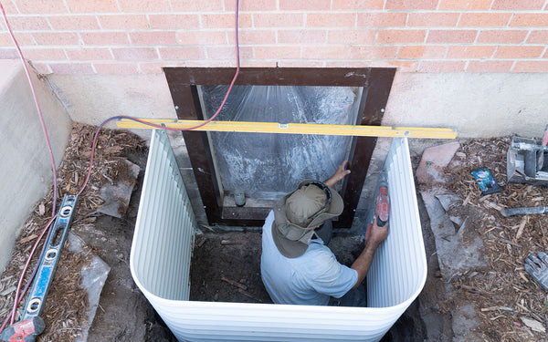 egress window installation - window well with interior flanges