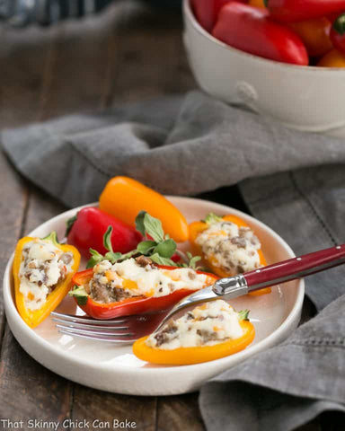 Cream Cheese Stuffed Mini Peppers via That Skinny Chick Can Bake