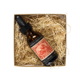 brothers artisan oil beard oil orange and grapefruit bottle in package