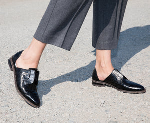 A Freda Handcrafted Classic. The WEAR women's loafer in Black Croc leather.