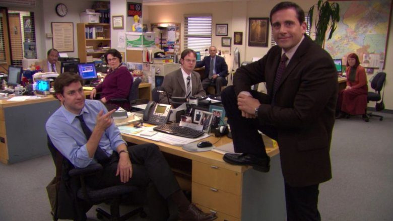 michael scott standing on a desk