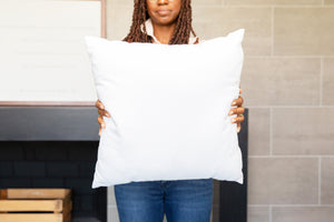 Black Model Holding Square Pillow Mockup #3 PSD